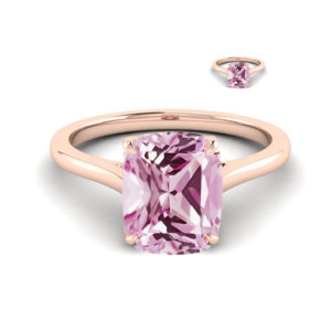 18k rose gold solitaire engagement ring with pink champagne sapphire center