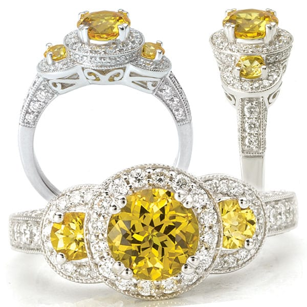 Three stone yellow sapphire and diamond halo engagement ring