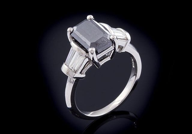 Black diamond and moissanite engagement ring