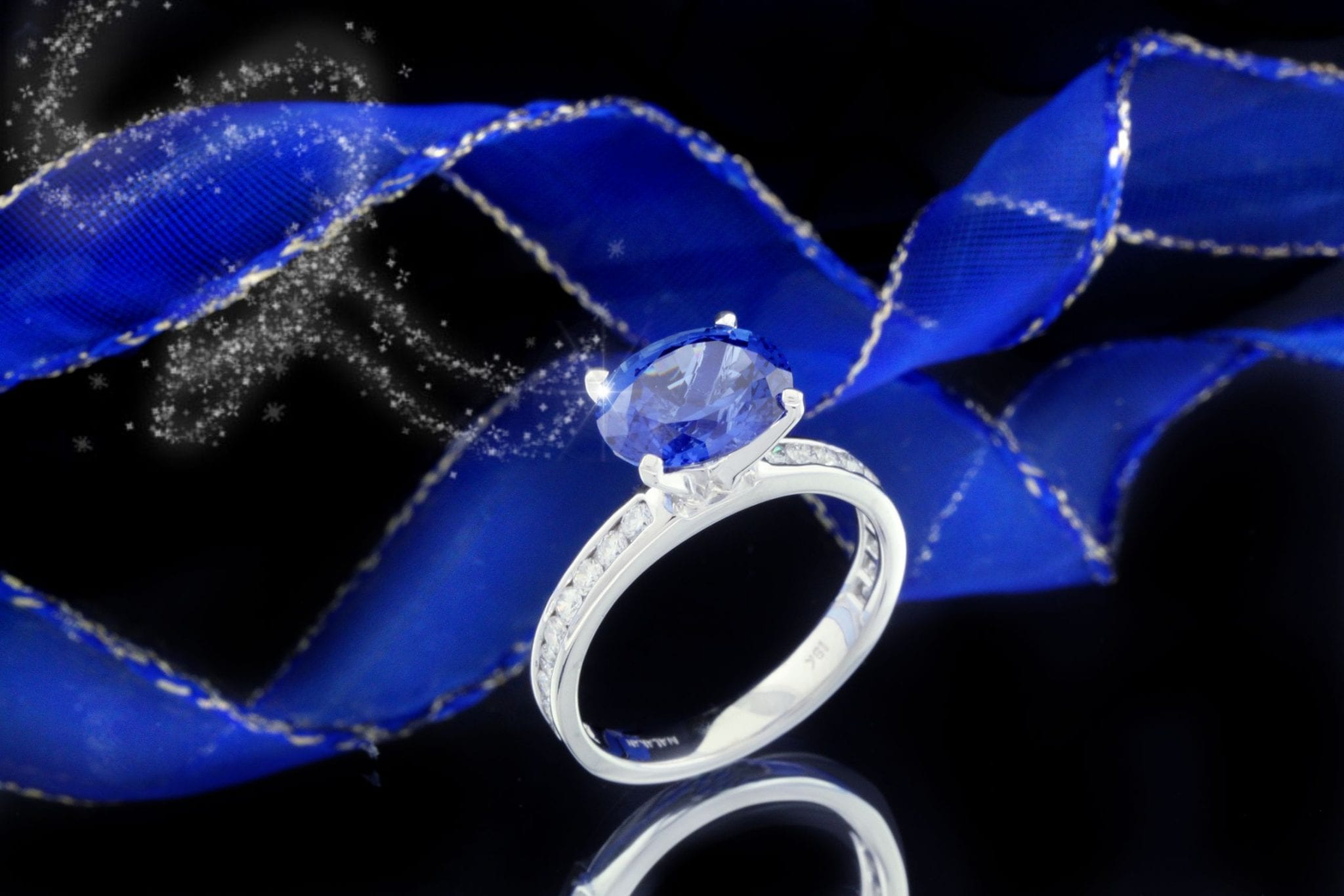 Oval Blue Sapphire And Diamond Engagement Ring